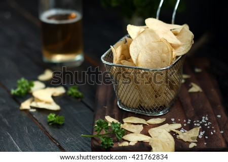 Crispy potato chips  on wooden background, top view - stock photo