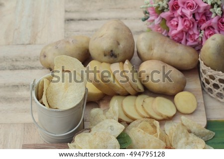 Crispy potato chips with salt and fresh potato