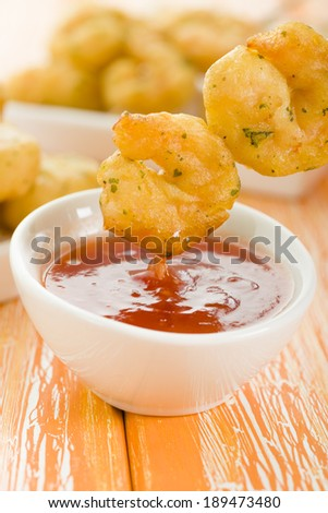 Crispy Prawns Skewers - Asian style fried battered prawns on skewers served with sweet chili dip. - stock photo