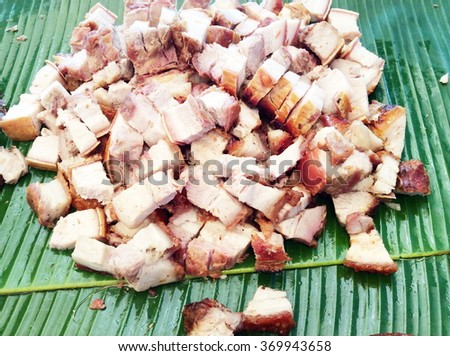 Crispy roasted pork on banana leaf - stock photo