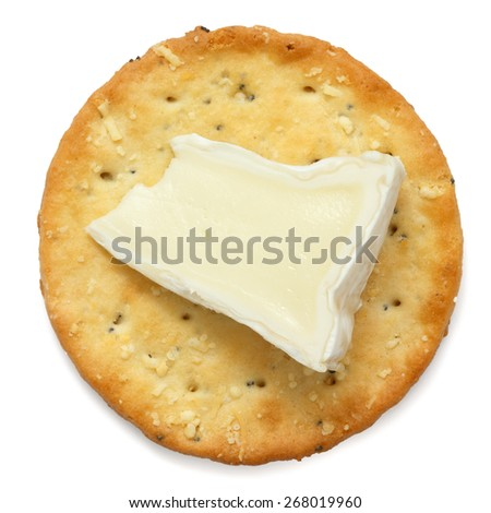 Crispy round cheese cracker from above. With brie. - stock photo