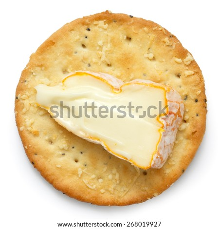 Crispy round cheese cracker from above. With French cheese.