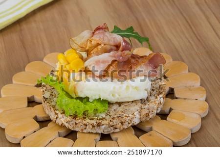 Sliced chicken cordon bleu with creamy sauce and romane leaf salad