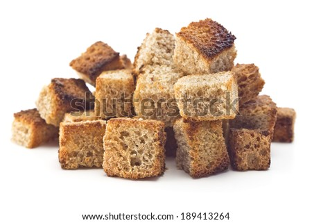 crispy slices of toasted bread on a white background - stock photo