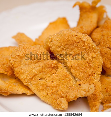 Crispy, Southern style fried fish on a plate. - stock photo