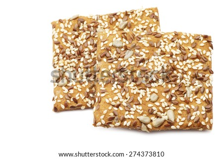 crispy spelt crackers with mixed seeds on a white background - stock photo