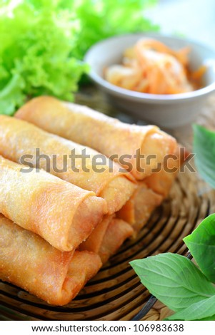 crispy spring rolls on clear dish with vegetable