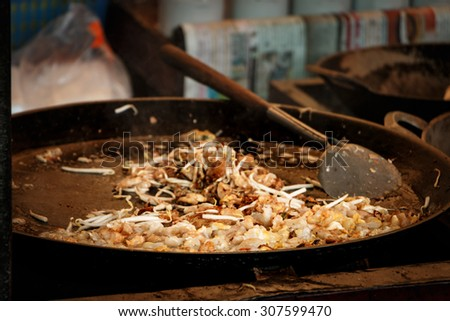 Crispy Thai Oyster Omelet name is HOY TOD on side street market, selective focus - stock photo