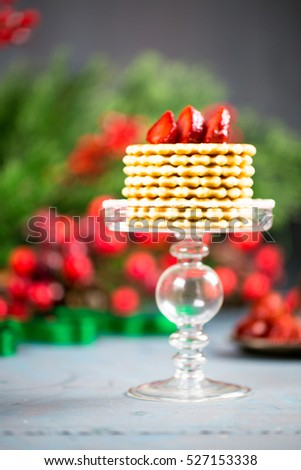 Crispy waffles stack served with fresh strawberries for Christmas