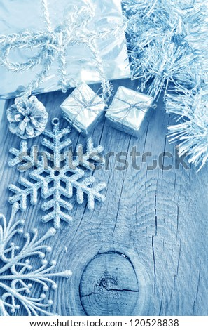 Cristmas decoration on the wooden background, present and snowflakes - stock photo