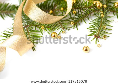 Cristmas seasonal background with spruce and golden beads isolated - stock photo