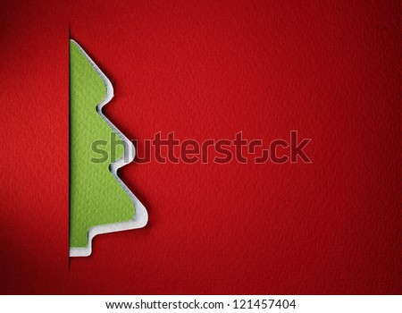 Cristmas tree paper cutting design card. - stock photo