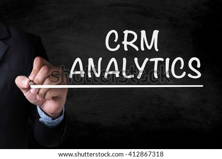 CRM ANALYTICS and Businessman drawing  Page on blackboard
