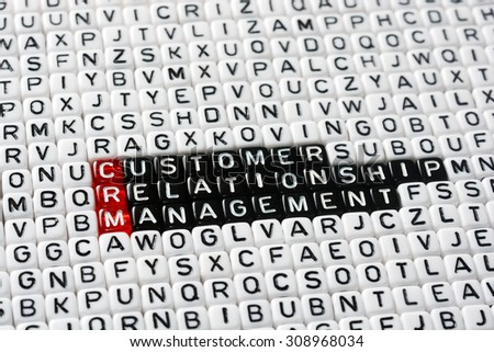 CRM Consumer Relationship Management on cubes , definition  - stock photo