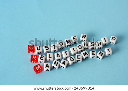 CRM Consumer Relationship Management on cubes , definition  acronym on blue - stock photo