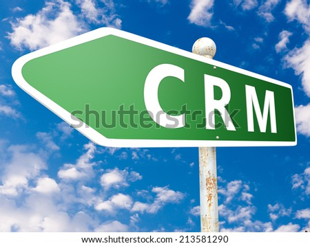 CRM - Customer Relationship Management - street sign illustration in front of blue sky with clouds. - stock photo