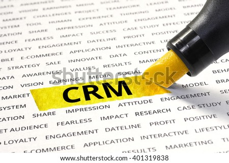 CRM message highlighted with marker on paper of other related words. For direction of business strategy success concept - stock photo