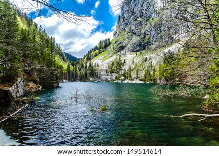 Crno jezero (Black lake), the lowest of all the Triglav Lakes. Slovenia. The warmest of the Triglav Lakes. It is named for its location in a basin in the middle of the forest, - stock photo