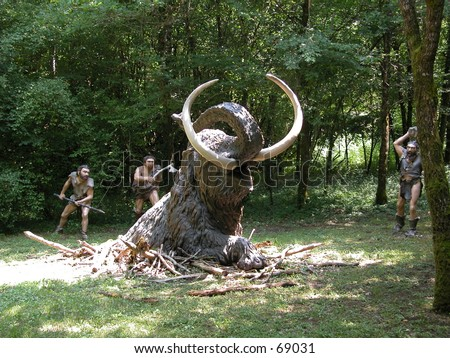 Cro magnon people hunting a mammuth (models in a theme park) - stock photo