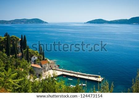 Croatia, adriatic sea and old village. View from Arboretum Trsteno - stock photo