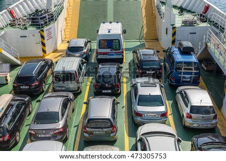 CROATIA, KRK - AUGUST 16, 2016: Cars on a ferry