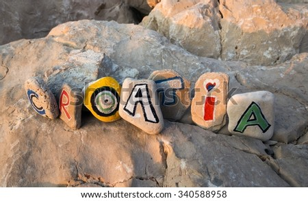 Croatia name painted on stones in the sun rays - stock photo