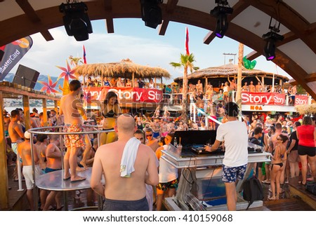 Croatia, Pag Island - July 24, 2015: Crowd of young people partying on a hot summer day on Zrce beach, Novalja, Pag island, Croatia. Zrce beach is the most popular party destination on Adriatic sea. - stock photo