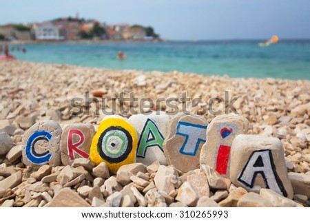 Croatia paint on stones on the beach adriatic sea background
