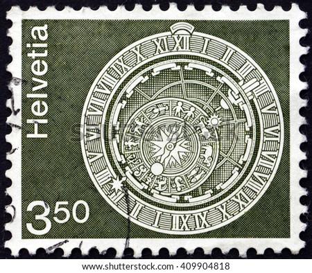 CROATIA ZAGREB, 21 FEBRUARY 2016: a stamp printed in the Switzerland shows Astronomical Clock, Bern Clock Tower, circa 1980 - stock photo