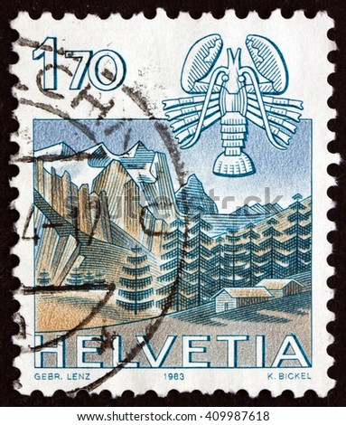 CROATIA ZAGREB, 21 FEBRUARY 2016: a stamp printed in the Switzerland shows Cancer, Wetterhorn, Grindelwald, Sign of the Zodiac and Nature View, circa 1983 - stock photo