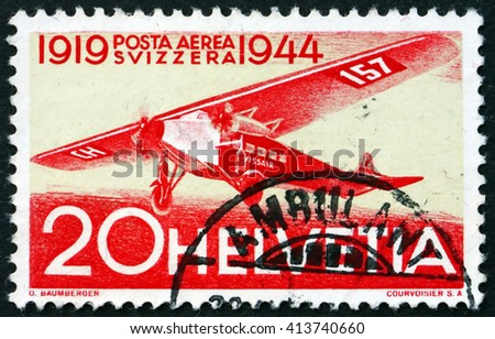CROATIA ZAGREB, 28 MARCH 2016: a stamp printed in the Switzerland shows Fokker, Airplane, 25th Anniversary of the 1st Regular Air Route in Switzerland, circa 1944 - stock photo
