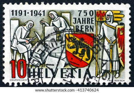 CROATIA ZAGREB, 28 MARCH 2016: a stamp printed in the Switzerland shows Masons, Knight and Bern Coat of Arms, 750th Anniversary of Bern, circa 1941 - stock photo
