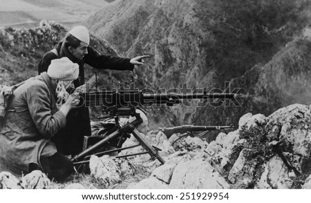 Croatian militia men and Muslims fighting, along with the Germans, against Tito's partisans. The combat takes place in the Bosnian mountains, 1944, in Yugoslavia, during World War 2. - stock photo