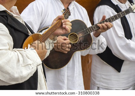 Croatian musicians in traditional Croatian folk costumes - stock photo