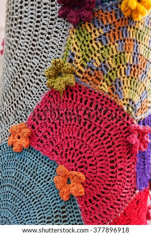 Crochet flowers pattern mosaic on tree