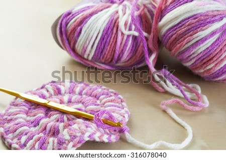 Crochet hook with Ball of wool yarn crocheting concept - stock photo