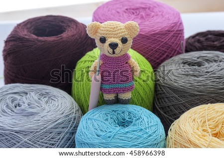 Crochet mini baer and varities ball of wool yarn and knitting needles. Handcraft equipment used for needlework as a hobby. - stock photo