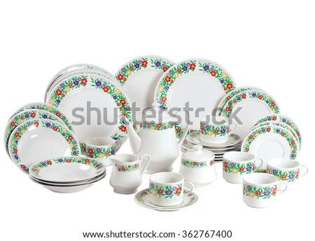 crockery plate table dish dinner porcelain teapot service - stock photo