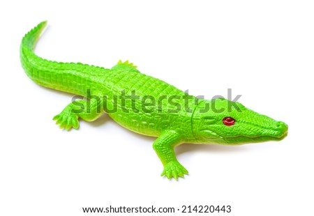 crocodile toy on white