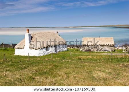 Croft houses near Traigh Ear beach - North Uist - stock photo