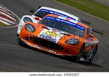 CROFT, UK - JUNE 20: Adam Morgan and Stefan Hodgetts race in round 13 of the Ginetta G50 cup on June 20, 2010 at Croft, North Yorkshire, UK