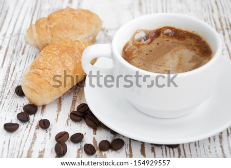 Croissant and a cup of delicious coffee