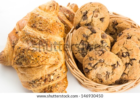 Croissant and cookies on white background