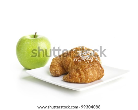Croissant and Green Apple isolated on white background