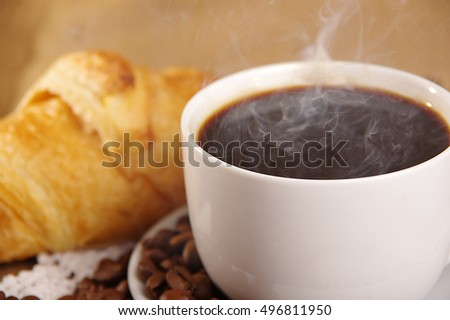 croissant, coffee and smoke