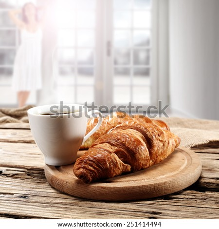 croissant coffee and woman with window of sun  - stock photo