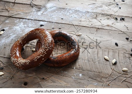 croissant on a wooden surface with milk - stock photo