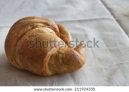 Croissant on the textured textile rustic tissue