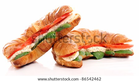 Croissant with basil, tomato and mozzarella over white background - stock photo