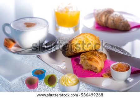 Croissant with coffee, butter, jam, juice, cake 2